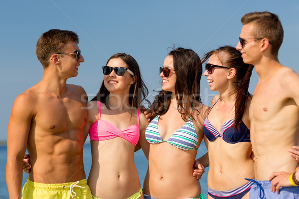улыбаясь друзей Солнцезащитные очки лет пляж дружбы Сток-фото © dolgachov