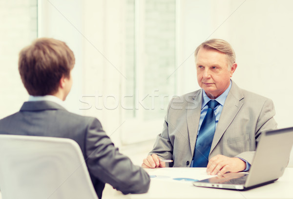 older man and young man having meeting in office Stock photo © dolgachov