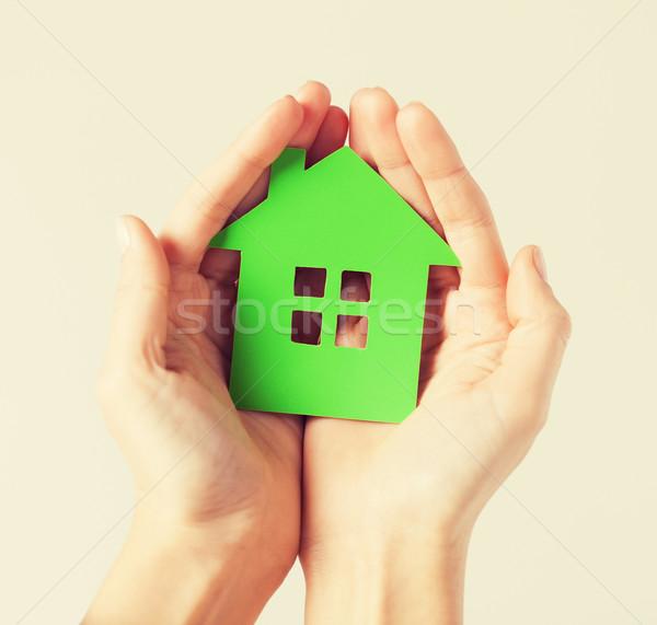 hands holding green house Stock photo © dolgachov