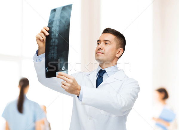 male doctor looking at x-ray in hospital Stock photo © dolgachov