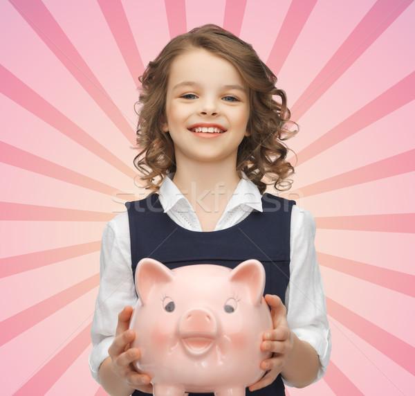happy girl holding piggy bank Stock photo © dolgachov