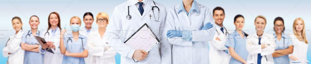 Enfermeira médico do sexo masculino cardiograma medicina pessoas Foto stock © dolgachov