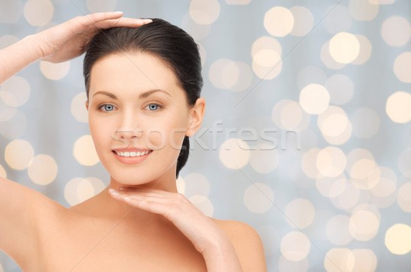 beautiful young woman touching her face and chin Stock photo © dolgachov