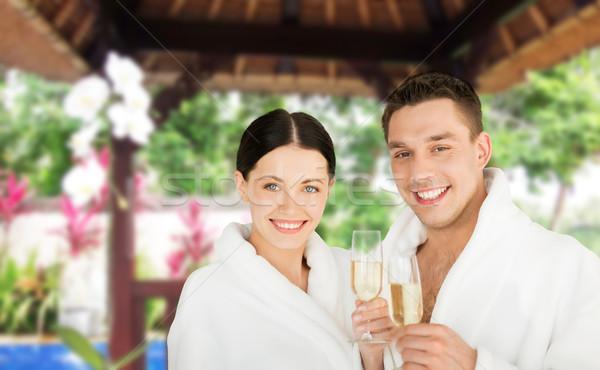 Boldog pár pezsgő üdülőhely emberek utazás Stock fotó © dolgachov