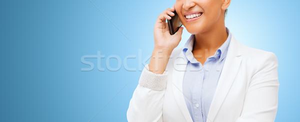 african businesswoman calling on smart phone Stock photo © dolgachov