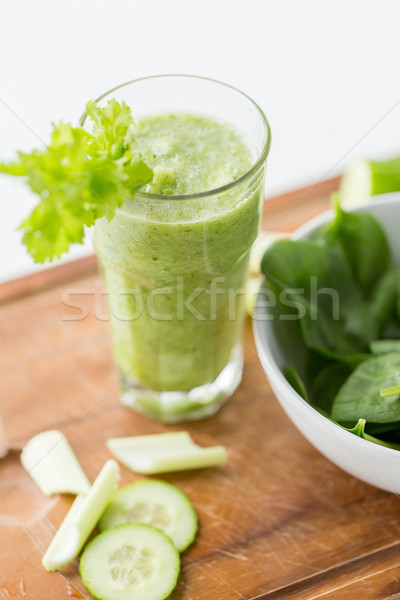 close up of fresh green juice glass and celery Stock photo © dolgachov