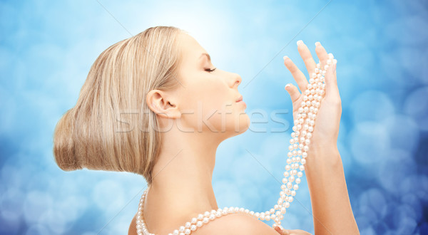 Belle femme mer perle collier bleu beauté Photo stock © dolgachov