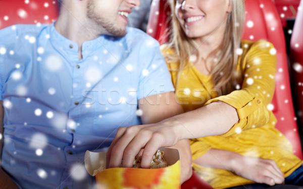 happy couple with popcorn in movie theater Stock photo © dolgachov