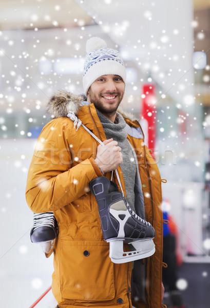 Boldog fiatalember korcsolyázás pálya emberek sport Stock fotó © dolgachov