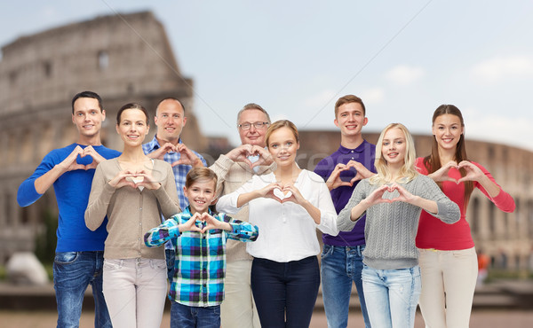 happy people showing heart hand sign over coliseum Stock photo © dolgachov
