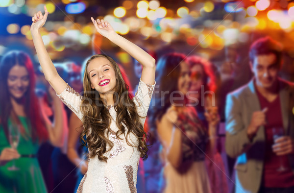 happy young woman or teen dancing at disco club Stock photo © dolgachov