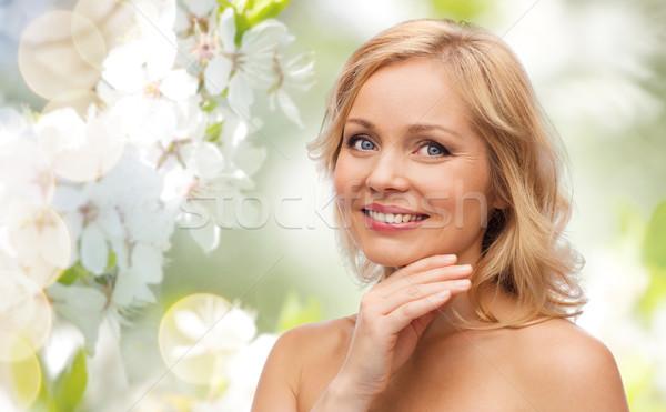 улыбающаяся женщина голый Плечи прикасаться лице красоту Сток-фото © dolgachov