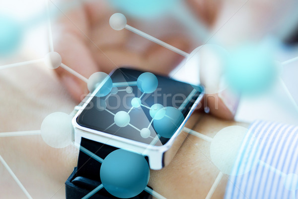 close up of hands with molecules on smartwatch Stock photo © dolgachov