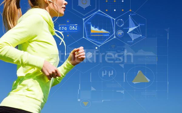 Mujer sonriente ejecutando aire libre tecnología deporte fitness Foto stock © dolgachov