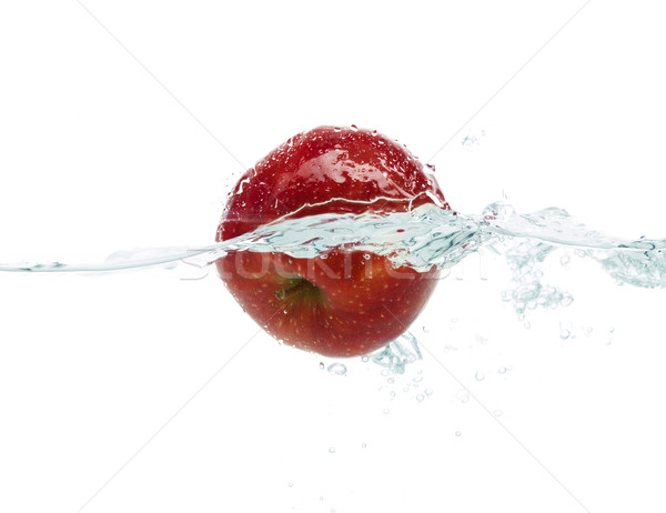 apple falling or dipping in water with splash Stock photo © dolgachov