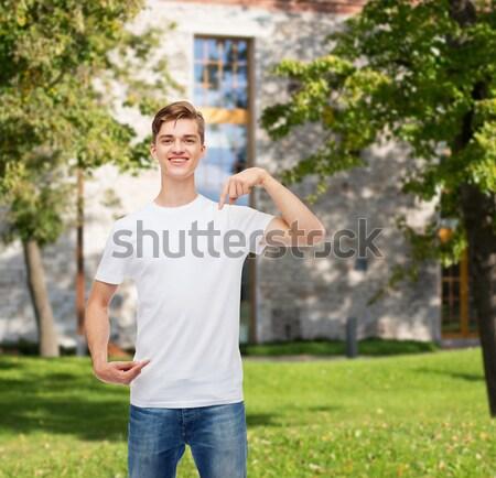 Unatkozik tinilány készít ujj fegyver kézmozdulat Stock fotó © dolgachov