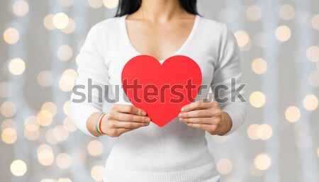 close up of male gay couple with red heart Stock photo © dolgachov