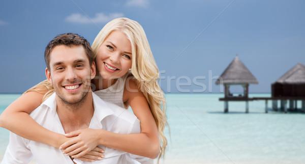 Boldog pár szórakozás tengerpart bungaló nyár Stock fotó © dolgachov