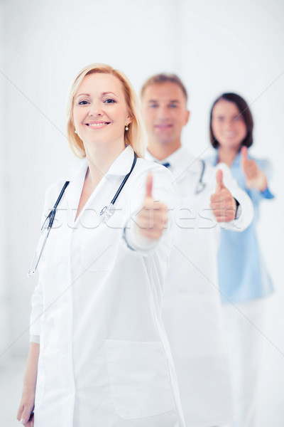 Stock photo: team of doctors showing thumbs up