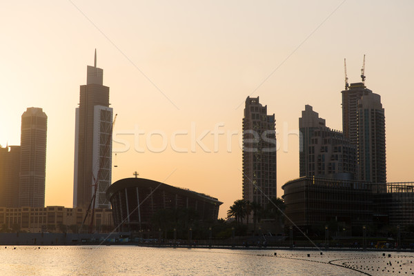 Dubai city skyscrapers on seafront at evening Stock photo © dolgachov