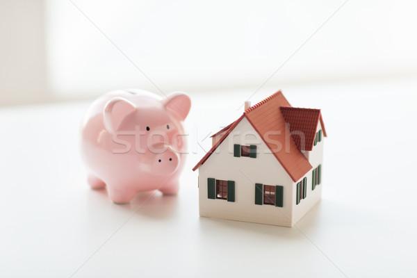 close up of house model and piggy bank Stock photo © dolgachov