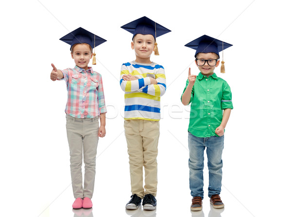Gelukkig kinderen vrijgezel hoeden bril jeugd Stockfoto © dolgachov