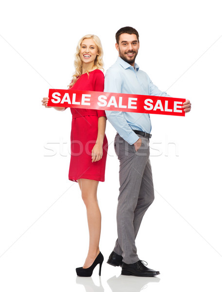 couple with red sale sign standing to back  Stock photo © dolgachov