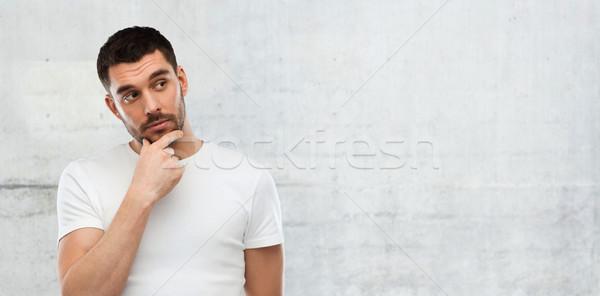 Férfi gondolkodik szürke fal kétség emberek Stock fotó © dolgachov