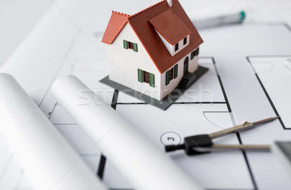 close up of house model on architectural blueprint Stock photo © dolgachov