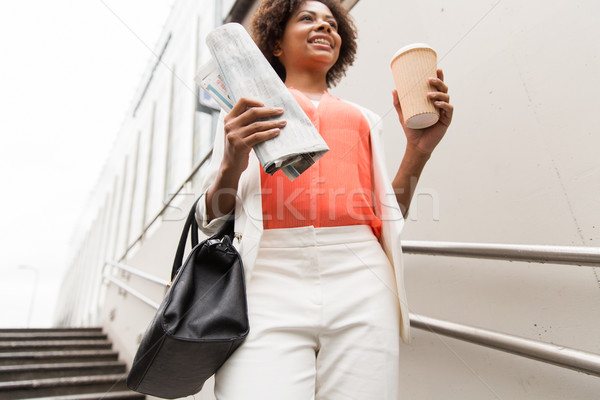 close up of woman with coffee and newspaper Stock photo © dolgachov