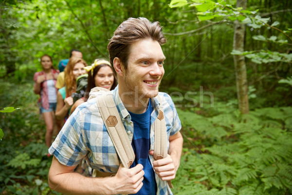 group of smiling friends with backpacks hiking Stock photo © dolgachov