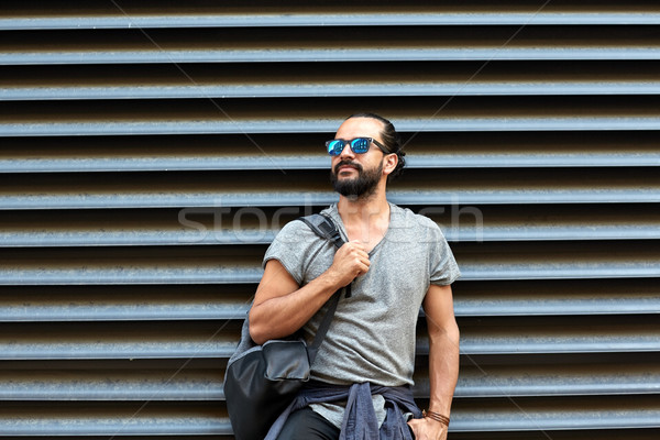 Stock photo: man with backpack standing at city street wall