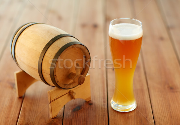 close up of beer glass and wooden barrel on table Stock photo © dolgachov