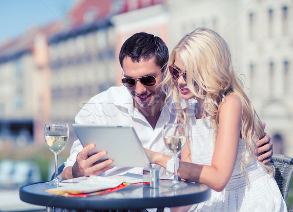 couple looking at tablet pc in cafe Stock photo © dolgachov