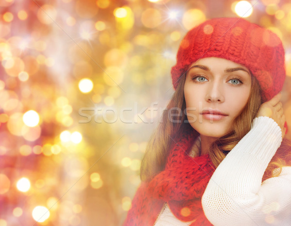 happy woman in hat, scarf and pullover over lights Stock photo © dolgachov
