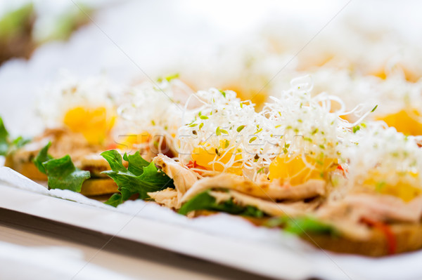 close up of canape or sandwiches on serving tray Stock photo © dolgachov