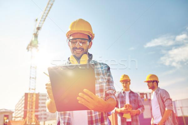 építész munkavédelmi sisak vágólap építkezés üzlet épület Stock fotó © dolgachov