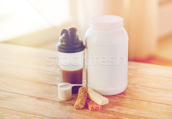 close up of protein food and additives on table Stock photo © dolgachov