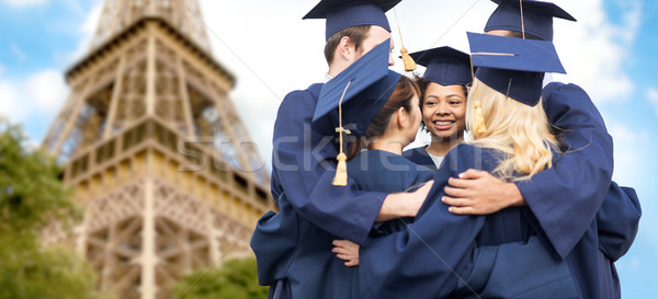 students or bachelors hugging over eiffel tower Stock photo © dolgachov