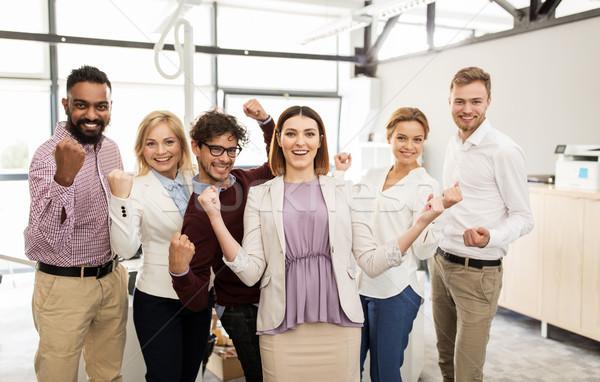 happy business team celebrating victory at office Stock photo © dolgachov