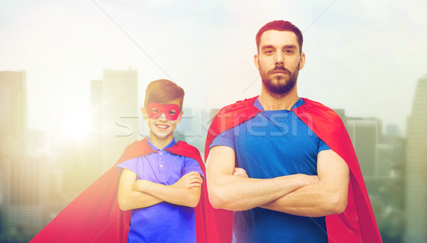 man and boy wearing mask and red superhero cape Stock photo © dolgachov