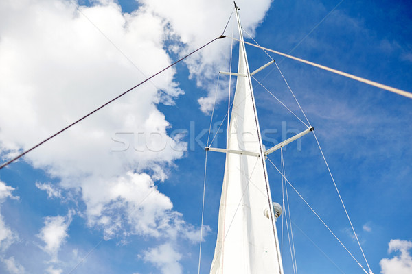 Stock photo: white sail on mast of boat over blue sky
