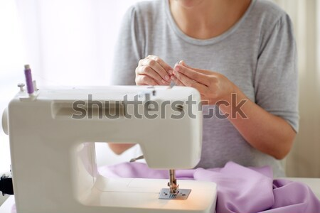 tailor woman with spool of sewing machine Stock photo © dolgachov