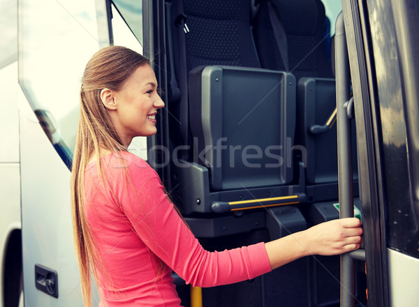 happy passenger boarding on travel bus Stock photo © dolgachov