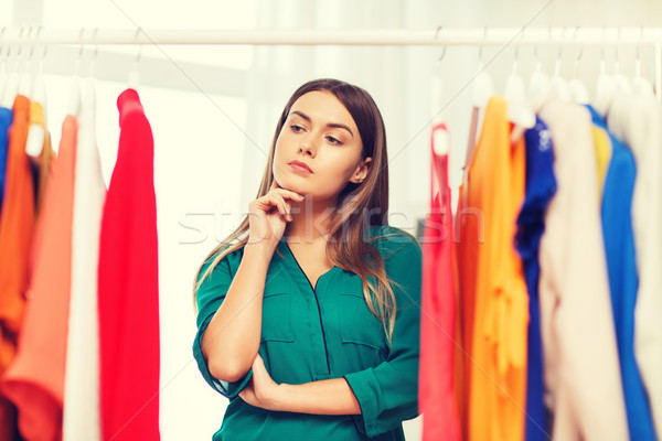 woman choosing clothes at home wardrobe Stock photo © dolgachov