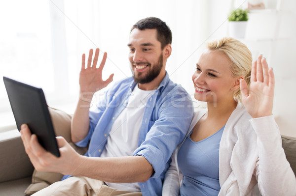 couple with tablet pc having video chat at home Stock photo © dolgachov