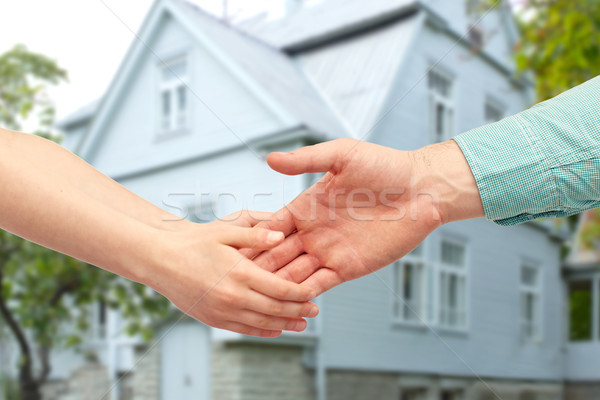father and child holding hands over house Stock photo © dolgachov