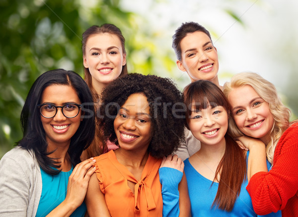 international group of happy women hugging Stock photo © dolgachov