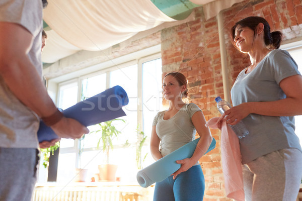 group of people with mats at yoga studio or gym Stock photo © dolgachov