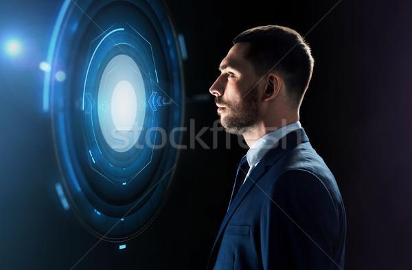 businessman looking at virtual projection Stock photo © dolgachov